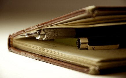 Image of pen and pencil inside journal by rafaelsoares, via Flickr