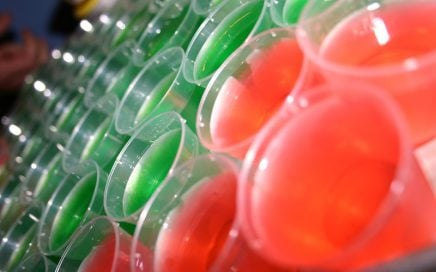 Image: rows of brightly colored Jell-o shots