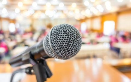 Image: microphone at front of conference room