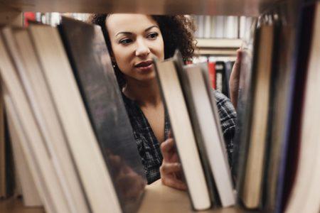 Image: woman browsing a bookshelf
