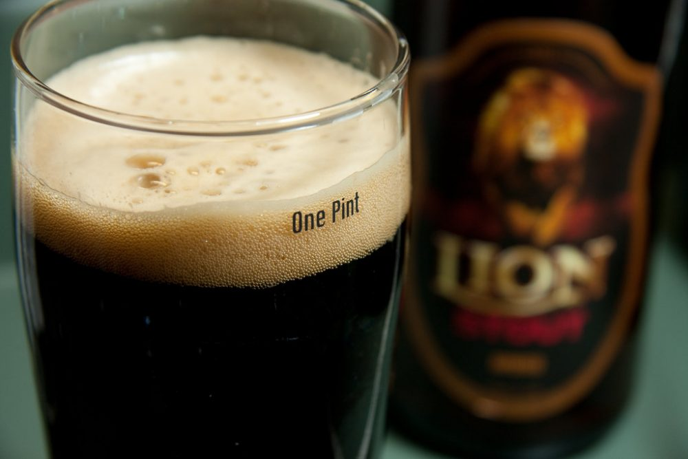 Image: pint glass full of Lion stout