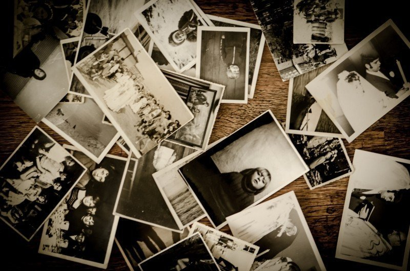 Image: old photos scattered around a table