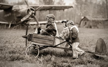 Image: little boys trying to launch homemade plane