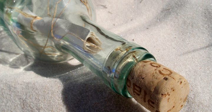 Message inside a glass bottle washed up on the beach