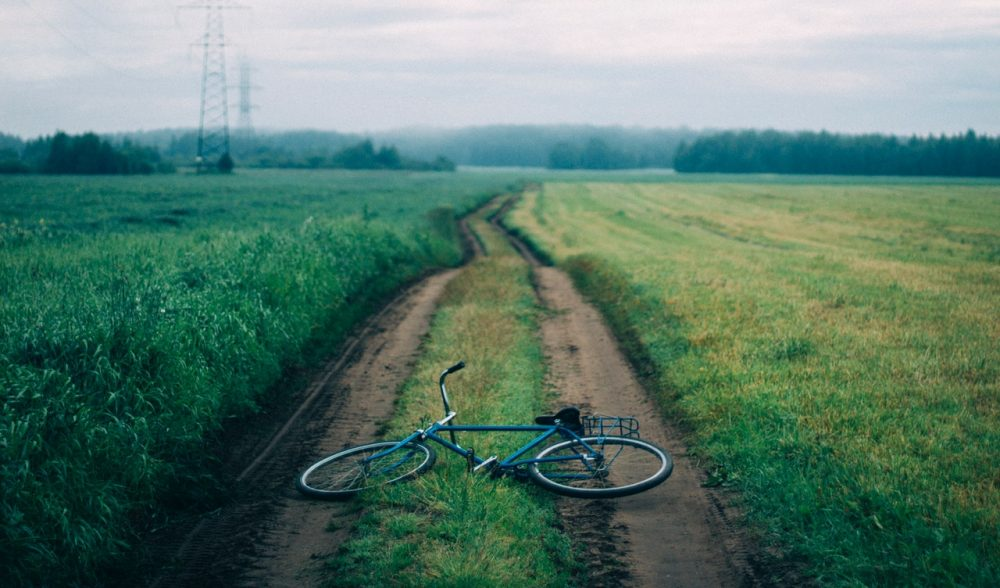 Image: abandoned bicycle in the middle of a rural road