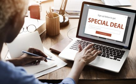 Image: woman at laptop with 'special deal' advertised on screen