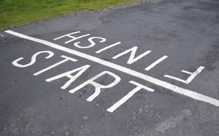 Image: start-finish line painted on a road for a foot race
