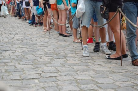 Image: people waiting in line