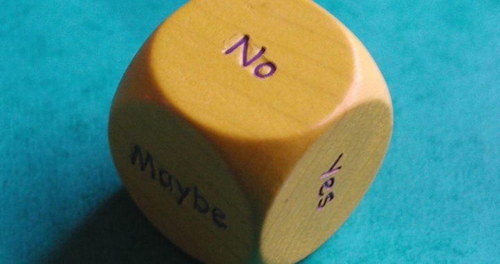 Image: six-sided die showing faces labeled Yes, No, and Maybe