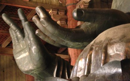 Image: hands of a large Buddha statue