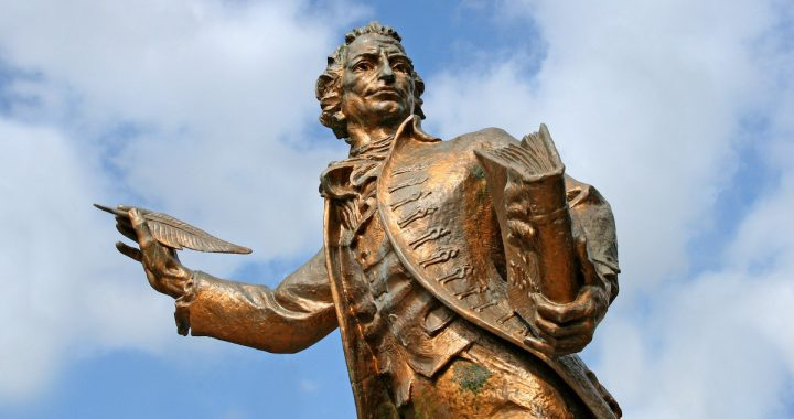 Image: statue of Thomas Paine holding book and quill pen