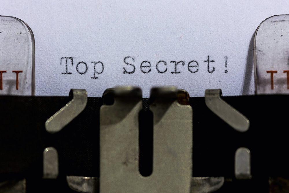 """Image: typewriter typing the words """"top secret"""""""