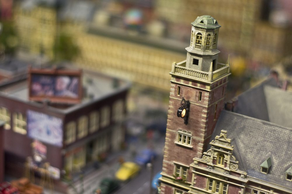 Image: close-up of a clock tower in a miniature city