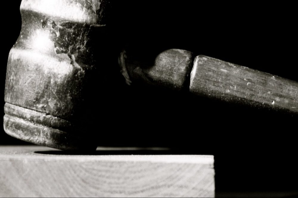 Image: black and white photo of a gavel