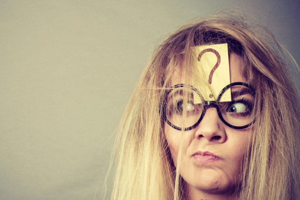 Image: puzzled woman with a question mark stuck to her forehead.