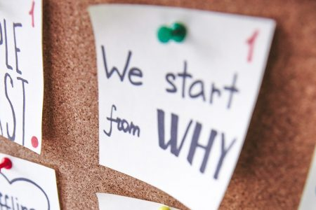 """Image: a note reading """"We start from WHY"""" pinned to a bulletin board."""