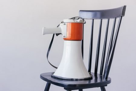 Image: a megaphone placed on a chair